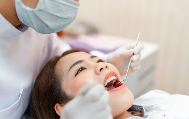 dentist examining teeth for tooth disorders